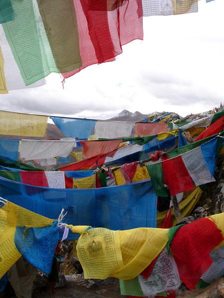 prayer flags on the kora at Ganden Monastery, Tibet