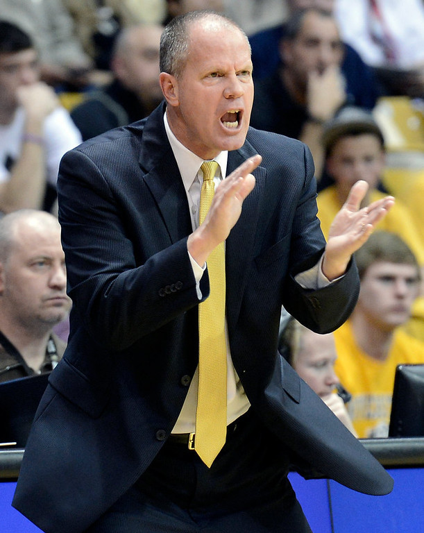 . University of Colorado Head Coach Tad Boyle tries to get his team pumped up during a game against Stanford on Thursday, Jan. 24, at the Coors Event Center on the CU campus in Boulder. Jeremy Papasso/ Camera