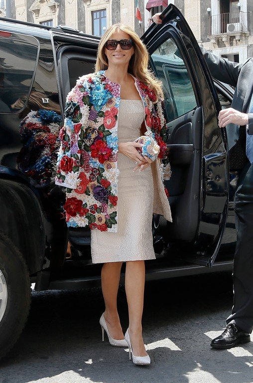 . FILE - In this May 26, 2017 file photo, first lady Melania Trump arrives at the City Hall, Palazzo degli Elefanti, in the Sicilian town of Catania, Italy, for a visit with some of the G7 leaders\' partners.  Slovenian-born Melania Trump has been unafraid to go against her husband�s �America First� agenda, and stay true to her roots, if there�s a message to be taken from her bold, foreign-flavored first lady wardrobe in 2017.  She is wearing a Dolce and Gabbana multicolored floral coat.  (AP Photo/Domenico Stinellis)