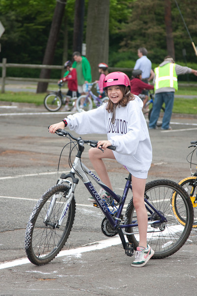 (1) Pslip Slug #: W 00019652; (2) Ridgewood, NJ; (3) 05/16/09; (4) Bike Rodeo and Safety Fair; (5) Chloe Rosichan prepares to ride in the Ridgewood Bike Rodeo and Safety Fair on 5/16/2009; (6) W.H. Grae for the Ridgewood News.