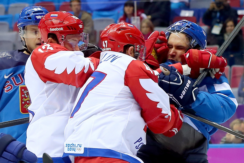 . Lauri Korpikoski #28 of Finland and Sami Lepisto #18 of Finland scuffle with Pavel Datsyuk #13 of Russia and Alexander Radulov #47 of Russia during the Men\'s Ice Hockey Quarterfinal Playoff on Day 12 of the 2014 Sochi Winter Olympics at Bolshoy Ice Dome on February 19, 2014 in Sochi, Russia.  (Photo by Martin Rose/Getty Images)