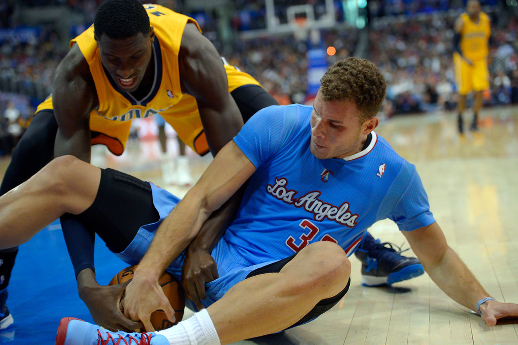 . Indiana Pacers center Ian Mahinmi, left, of France, and Los Angeles Clippers forward Blake Griffin battle for a loose ball during the second half of an NBA basketball game, Sunday, Dec. 1, 2013, in Los Angeles. (AP Photo/Mark J. Terrill)