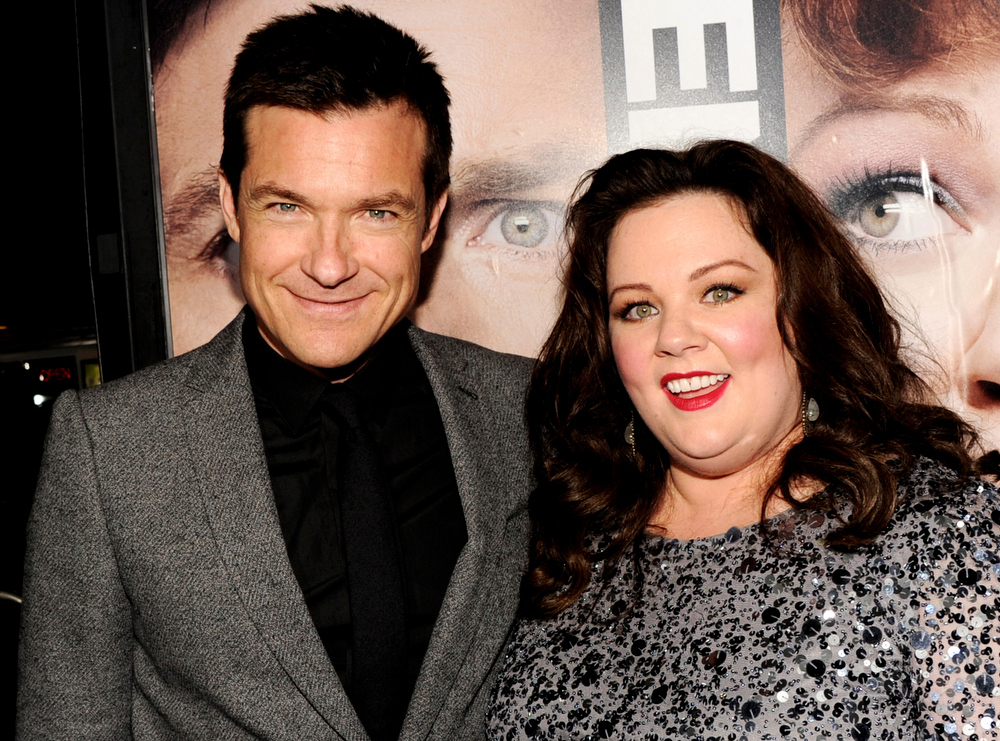 """. Actors Jason Bateman (L) and Melissa McCarthy arrive at the premiere of Universal Pictures\' \""""Identity Theft\"""" at the Village Theatre on February 4, 2013 in Los Angeles, California.  (Photo by Kevin Winter/Getty Images)"""