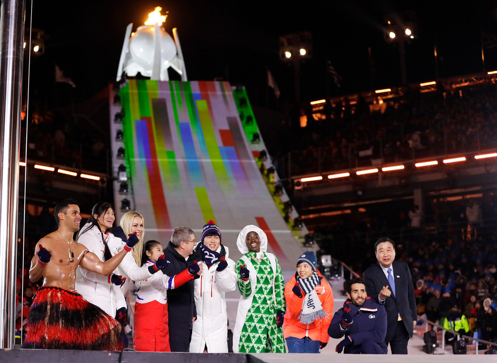 . Athletes from various nations including Pita Taufatofua, of Tonga, at left, United States\' Lindsey Vonn, third from left, and Thomas Bach, president of the International Olympic Committee, fifth from left, pose during the closing ceremony of the 2018 Winter Olympics in Pyeongchang, South Korea, Sunday, Feb. 25, 2018. (AP Photo/Kirsty Wigglesworth)