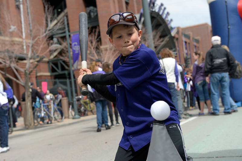 . Kyle Bubier, 7, tries out a batting game outside the stadium before the game during his 6th Rockies opening day in a row. The Colorado Rockies hosted the Arizona Diamondbacks in the Rockies season home opener at Coors Field in Denver, Colorado Friday, April 4, 2014. (Photo by Craig F. Walker/The Denver Post)