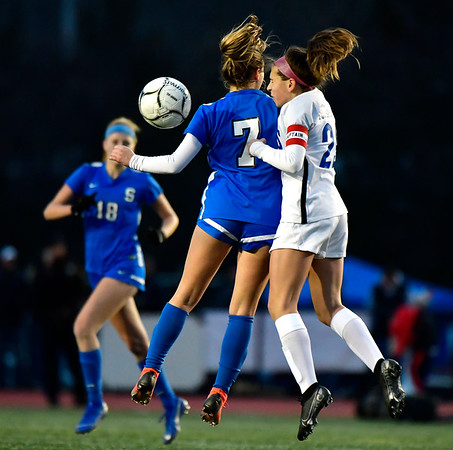 11/23/2019 Mike Orazzi | StaffrGlastonbury High School's Alexandra Bedard (29) and Southington High School's Emma Panarella (7) during the Class LL Girls State Soccer Tournament at Veterans Stadium in New Britain Saturday evening. Glastonbury defeated Southington 1-0. r