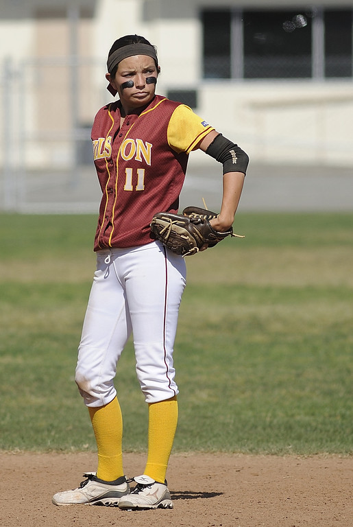 . LONG BEACH, CALIF. USA -- Wilson\'s Kori Cochran (11) is upset about dropping a fly ball against Lakewood in Lakewood, Calif., on May 2, 2013. If Cochran had held on to the ball the inning would have been over, instead Lakewood went on to score more runs.  Photo by Jeff Gritchen / Los Angeles Newspaper Group