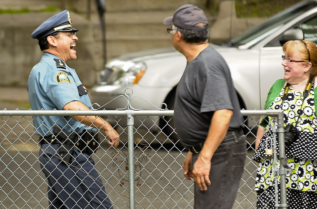. St. Paul Police Commander John Lozoya, left, chats with Jim and Holly Wardlaw outside their home. (Pioneer Press: Ben Garvin)