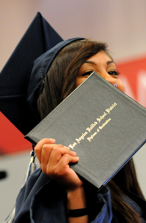. A student shows off her diploma at the Northridge Academy High School graduation ceremony on Thursday, June 5, 2014. (Photo by Dean Musgrove/Los Angeles Daily News)