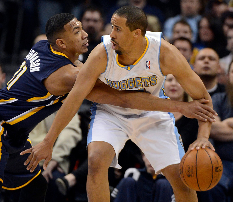 . DENVER, CO. - JANUARY 28: Indiana Pacers shooting guard Orlando Johnson (11) reaches in on Denver Nuggets point guard Andre Miller (24) during the second quarter January 28, 2013 at Pepsi Center. The Denver Nuggets host  the Indiana Pacers in NBA Action. (Photo By John Leyba / The Denver Post)