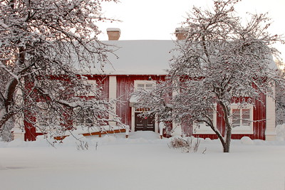 Red farm-house in the snow