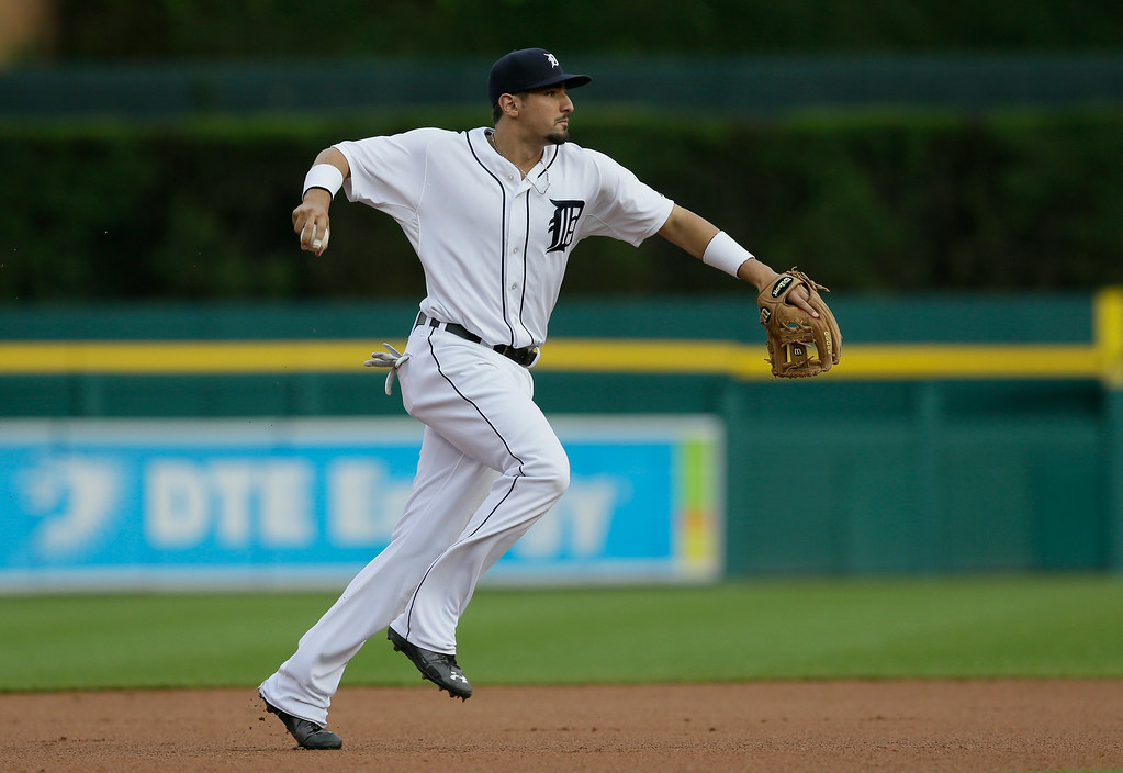 . Detroit Tigers third baseman Nick Castellanos throws out Chicago White Sox\'s Jose Abreu at first during the first inning of a baseball game, Wednesday, July 30, 2014 in Detroit. (AP Photo/Carlos Osorio)
