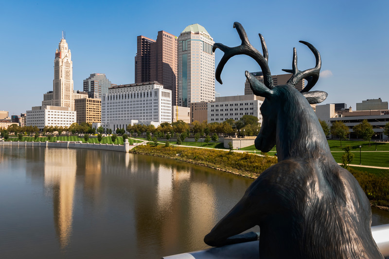 "Columbus, OH.  This human like bronze deer sculpture is the creation of artist and country singer Terry Allen.  The inspiration?  The name ""Scioto"" comes from the Shawnee American Indian word for ""hairy water"" because the Shawnee Indians found deer hair floating in the river after migrating from the Carolinas."