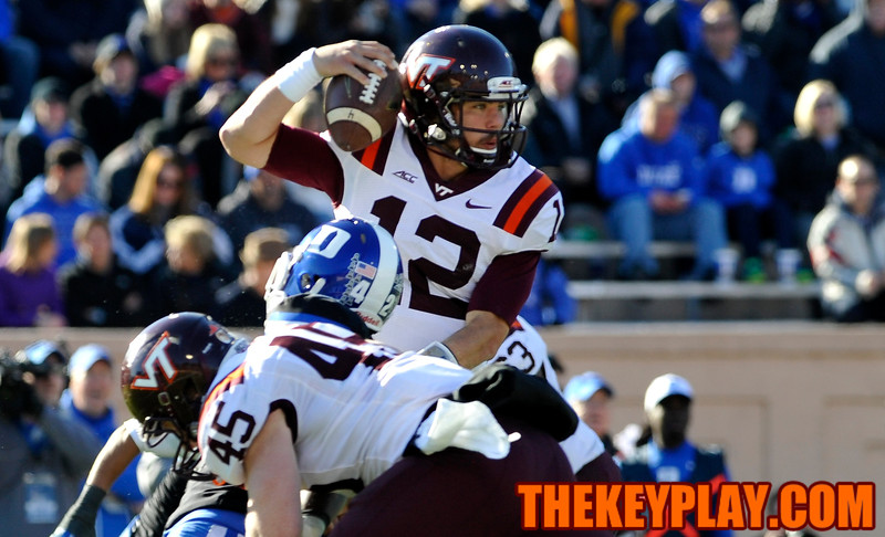 Virginia Tech quarterback Michael Brewer (12) makes a move to avoid the Duke rush. (Michael Shroyer/ Thekeyplay.com)
