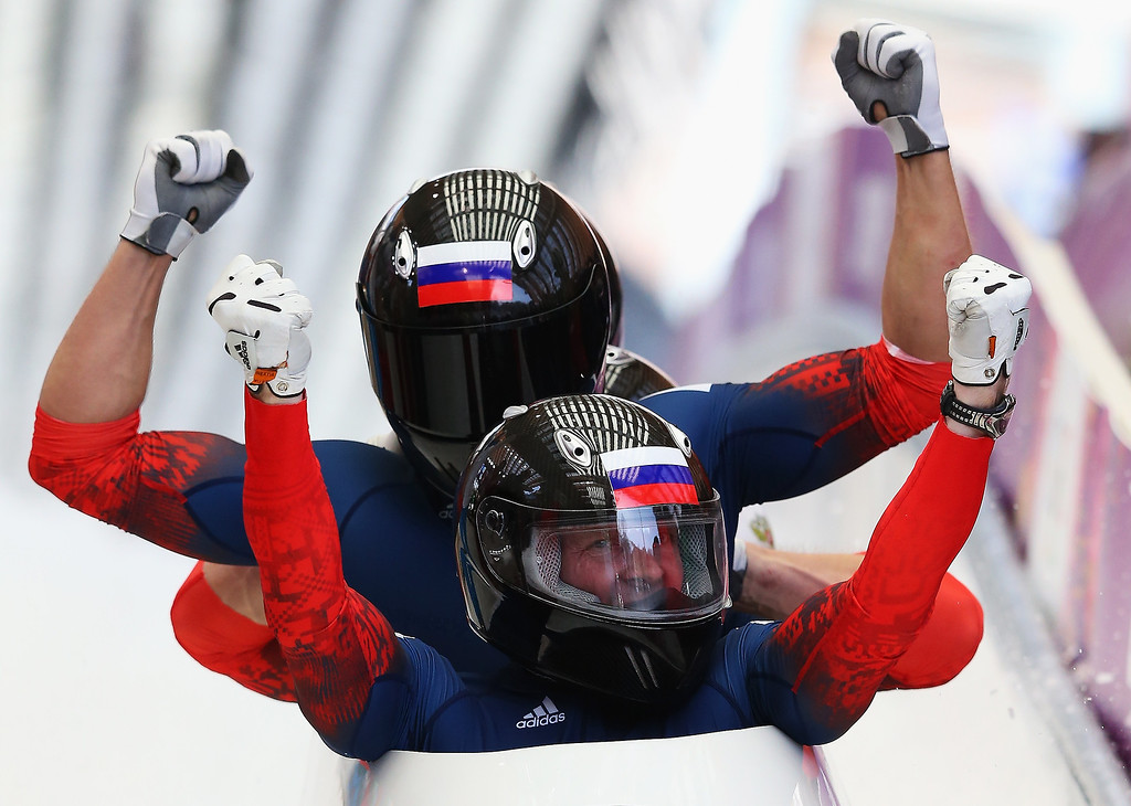 . Pilot Alexander Zubkov, Alexey Negodaylo, Dmitry Trunenkov and Alexey Voevoda of Russia team 1 celebrate winning the gold medal during the Men\'s Four-Man Bobsleigh on Day 16 of the Sochi 2014 Winter Olympics at Sliding Center Sanki on February 23, 2014 in Sochi, Russia.  (Photo by Alex Livesey/Getty Images)