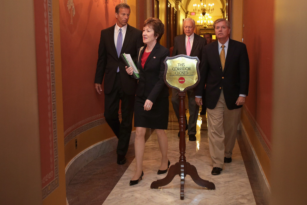 . (L-R) Sen. John Thune (R-SD), Sen. Susan Collins (R-ME), Sen. Orrin Hatch (R-UT) and Sen. Lindsey Graham (R-SC) leave a Republican Senate caucus meeting at the U.S. Capitol September 30, 2013 in Washington, DC.   (Photo by Chip Somodevilla/Getty Images)