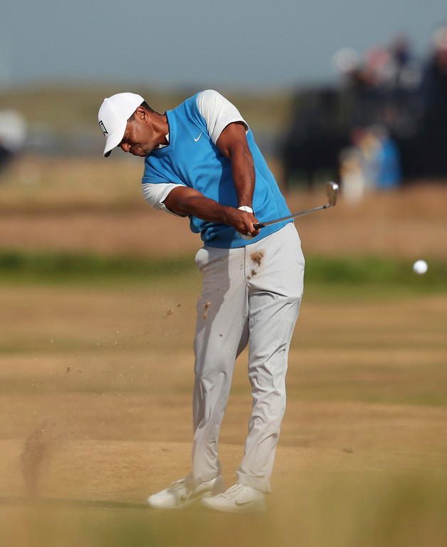 . Tiger Woods of the US plays a shot on the 7th hole during the first round of the British Open Golf Championship in Carnoustie, Scotland, Thursday July 19, 2018. (AP Photo/Jon Super)
