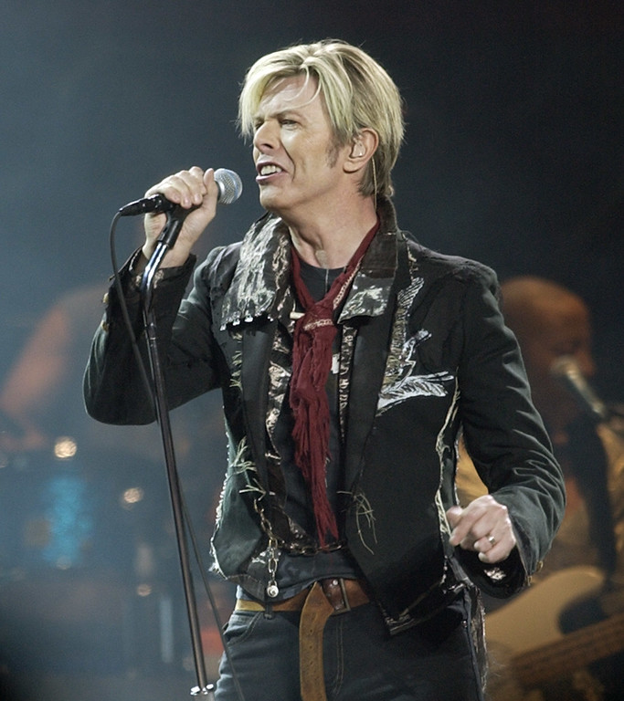 ". FILE - In this Dec. 15, 2003 file photo, singer/songwriter David Bowie launches his United States leg of his worldwide tour called ""A Reality Tour,\"" at Madison Square Garden in New York. Bowie, the innovative and iconic singer whose illustrious career lasted five decades, died Monday, Jan. 11, 2016, after battling cancer for 18 months. He was 69 (AP Photo/Kathy Willens, File)"