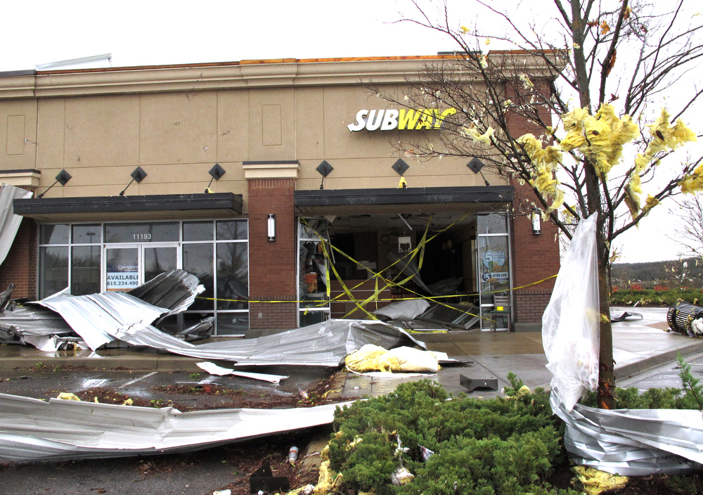 . A Subway sandwich store was severely damaged on Wednesday, Jan. 30, 2013, in Mount Juliet, Tenn.  Forecasters examined the damage path of 4.6 miles Wednesday morning and estimated the peak wind speed at 115 mph, qualifying the tornado as an EF-2 twister. The path of damage was about 150 yards wide. (AP Photo/Kristin M. Hall)