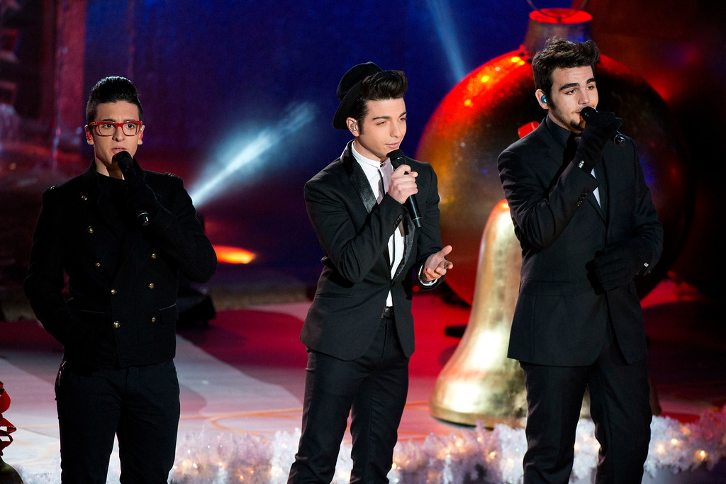. FILE - This Nov. 28, 2012 file photo shows Il Volo performinf at the 80th annual Rockefeller Center Christmas tree lighting ceremony on  in New York. Il Volo is releasing a Spanish album, �Qué más amor�, out Abril 9, with collaborations of Spaniard tenor Placido Domingo, Italian crooner Eros Ramazzotti and Mexican pop star Belinda. (Photo by Charles Sykes/Invision/AP, file)