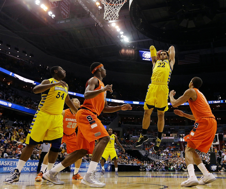 . Marquette guard Trent Lockett (22) pulls in a rebound during the first half of the East Regional final in the NCAA men\'s college basketball tournament against Syracuse, Saturday, March 30, 2013, in Washington. (AP Photo/Pablo Martinez Monsivais)