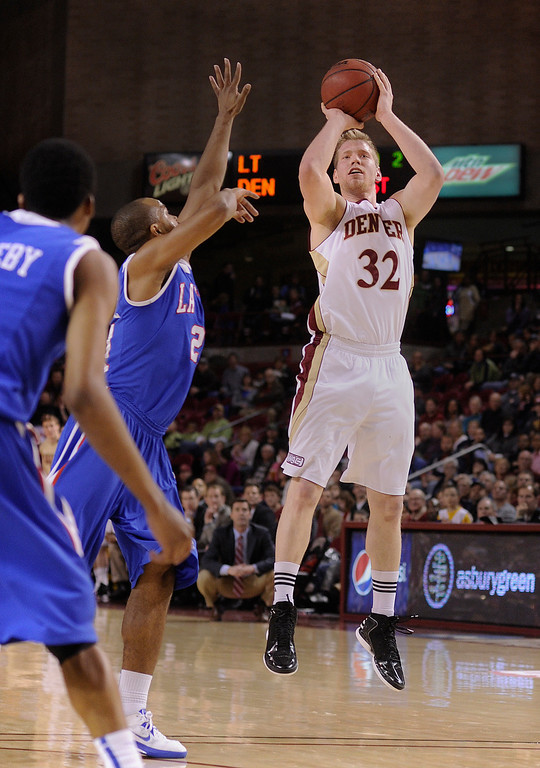 . Pioneers guard Chase Hallam (32) drained a jump shot in the first half. The University of Denver men\'s basketball team hosted the Louisiana Tech Bulldogs at Magness Arena Saturday night, March 9, 2013. (Photo By Karl Gehring/The Denver Post)