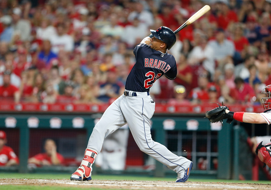 . Cleveland Indians\' Michael Brantley (23) doubles off Cincinnati Reds relief pitcher Amir Garrett (50) scoring Yandy Diaz, during the sixth inning of a baseball game, Monday, Aug. 13, 2018, in Cincinnati. (AP Photo/Gary Landers)