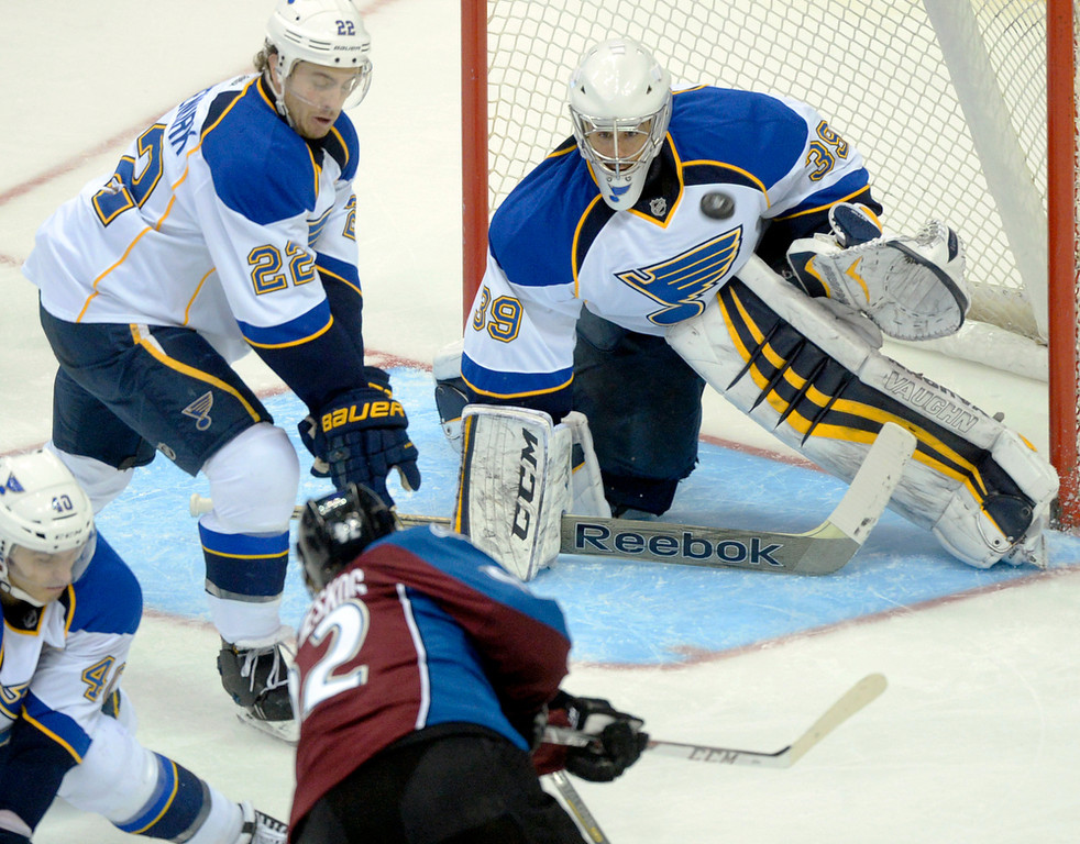 . Colorado wing Gabriel Landeskog (92) fired a shot on St. Louis goaltender Ryan Miller (39) in the second period. The St. Louis Blues defeated the Colorado Avalanche 2-1 at the Pepsi Center Saturday afternoon, March 8, 2014 in Denver, Colorado. (Photo by Karl Gehring/The Denver Post)