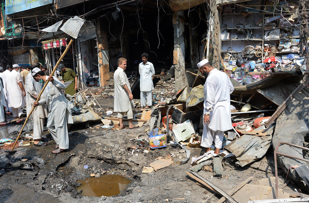 . Pakistani shop owners gather at the site of a bomb explosion in the busy Kissa Khwani market in Peshawar on September 29, 2013. AFP PHOTO /  A. MAJEED/AFP/Getty Images