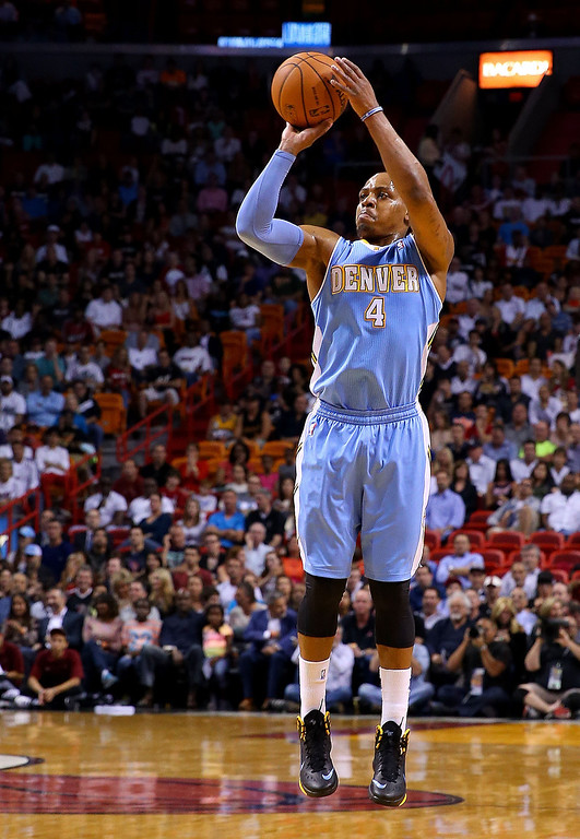 . MIAMI, FL - MARCH 14:  Randy Foye #4 of the Denver Nuggets shoots during a game against the Miami Heat at American Airlines Arena on March 14, 2014 in Miami, Florida. (Photo by Mike Ehrmann/Getty Images)