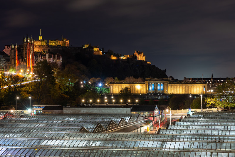Edinburgh Castle and Waverley Station at night