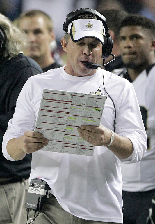 . New Orleans Saints head coach Sean Payton looks at plays against the Atlanta Falcons during the first half of an NFL football game, Thursday, Nov. 21, 2013, in Atlanta. (AP Photo/Dave Martin)