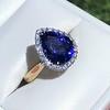 7.00ctw Tanzanite and Diamond Halo Ring 0