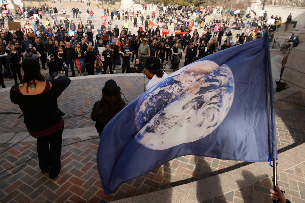 . DENVER, CO- FEBRUARY 17:   Members of Earth Guardians perform during the rally at Civic Center Park with a flag of the Earth waving in the back round    A few hundred people from a coalition of students, faith-based organizations, indigenous, political, and environmental groups marched from the Denver Auraria campus and ended in a rally at Civic Center Park on February 17th, 2013.  The march, called the #ForwardOnClimate Solidarity March and rally, organized by the Sierra Club, 350.org and GoFossilFree.org,  coincided with tens of thousands of protestors, who converged on Washington, DC for the largest climate rally in history. Denver was one of 18 cities hosting major actions to show solidarity with the DC event.    (Photo By Helen H. Richardson/ The Denver Post)