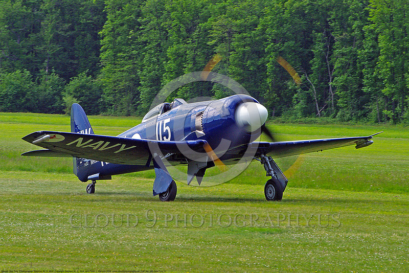 WB-Sea Fury 00017 A blue Hawker Sea Fury fighter taxis on beautiful grass warbird picture by Stephen W. D. Wolf.JPG