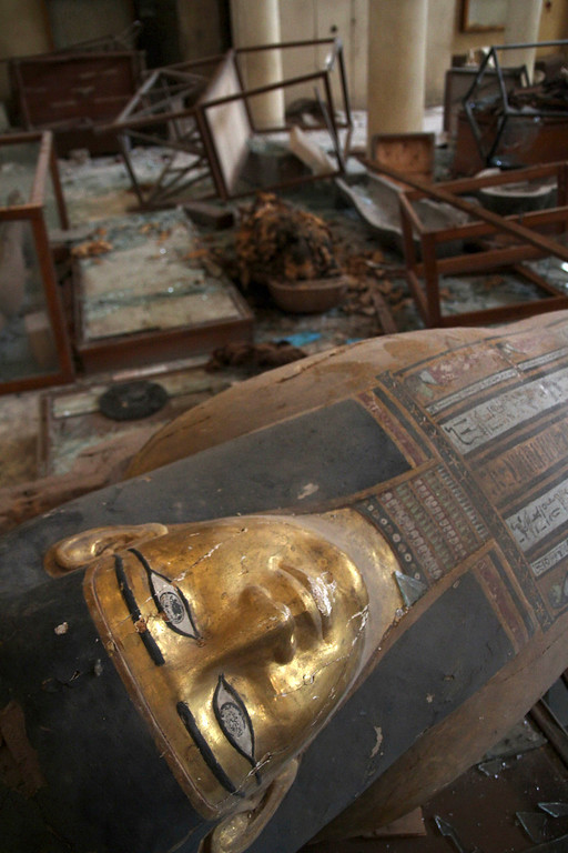 . Damaged pharaonic objects lie on the floor of the Malawi Antiquities Museum after it was  ransacked and looted between the evening of Thursday, Aug. 15 and the morning of Friday, Aug. 16, 2013, in Malawi, south of Minya, Egypt, Saturday, Aug. 17, 2013. The interim Cabinet authorized police to use deadly force against anyone targeting police and state institutions on Thursday. The violence capped off a week that saw more than 700 people killed across the country. (AP Photo/Roger Anis, El Shorouk Newspaper)