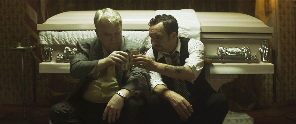 ". This photo provided by the Sundance Institute shows, Philip Seymour Hoffman, left, and Eddie Marsan, in a scene from the film, \""God\'s Pocket.\"" The Sundance Film Festival runs Jan. 16-26, 2014, in Park City, Utah.  (AP Photo/Sundance Institute, Lance Acord)"