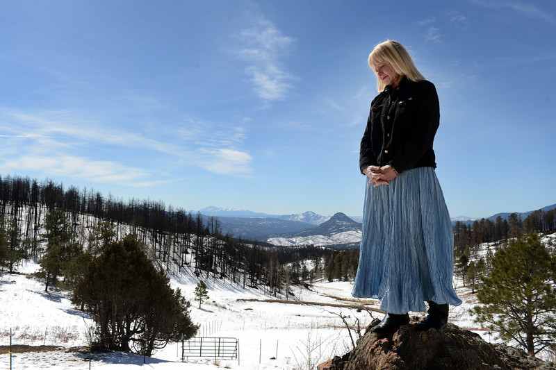 . Beth Semptimphelter poses for a portrait overlooking her property that was destroyed in the Lower North Fork fire last year, in Unincorporated Jefferson County, CO March 14, 2013. The wildfire killed three people and destroyed 27 homes. (Photo By Craig F. Walker/The Denver Post)