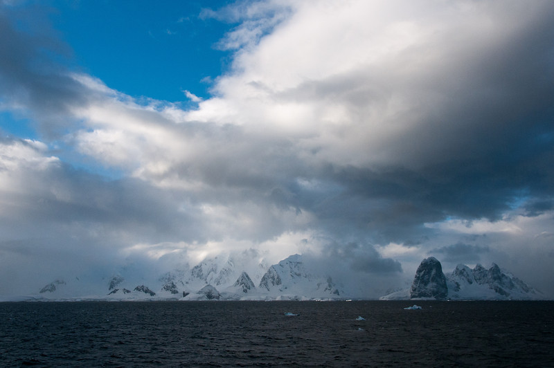 Snow covered mountains in Lemaire Channel, Antarctica