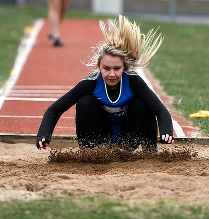 4/17/2018 Mike Orazzi | Staff Plainville's Agata Kuczynko in the long jump at Bristol Eastern Tuesday.