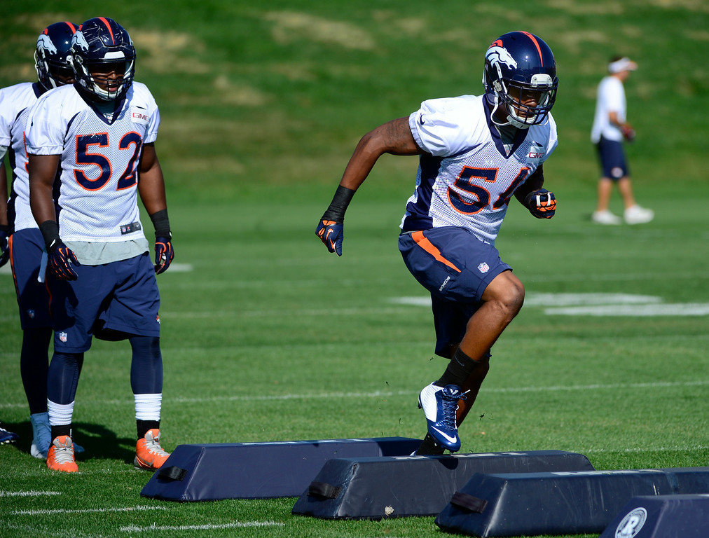 . Brandon Marshall (54), right, runs through drills with the rest of the linebackers. The Denver Broncos practice at Dove Valley on Monday, Sept. 1, 2014 in preparation for their season opener against the Indianapolis Colts on Sunday night. (Kathryn Scott Osler/The Denver Post)