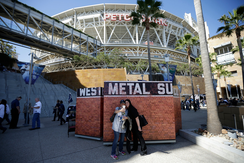 . Debbie Millanger, right, and Christina Miani, take a photo before an opening day baseball game between the Los Angeles Dodgers and the San Diego Padres on Sunday, March 30, 2014, in San Diego. (AP Photo/Gregory Bull)