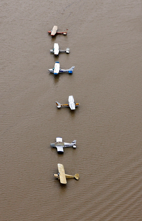 . Airplanes sit at a flooded airport near the Addicks Reservoir as floodwaters from Tropical Storm Harvey rise Tuesday, Aug. 29, 2017, in Houston. (AP Photo/David J. Phillip)