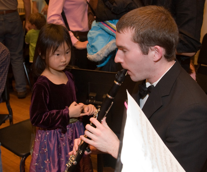 James Livengood, clarinet, with child  -- Hopkins Symphony Orchestra, March 2008