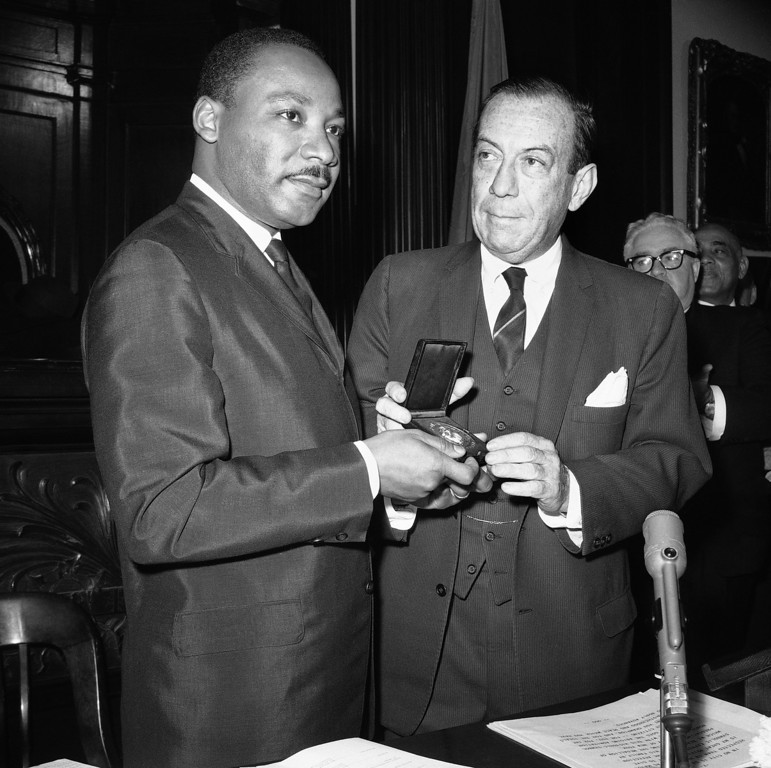 . The Rev. Martin Luther King Jr., left, civil rights leader and Nobel Peace Prize winner, receives the City of New York?s Medallion of Honor from Mayor Robert F. Wagner in City Hall ceremony in New York City on Dec. 17, 1964. (AP Photo/Anthony Camerano)