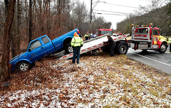 2/13/2020 Mike Orazzi | Staff The scene where a truck went off South Main Street and wound up in the woods in Plymouth near Lane Hill Road on Thursday afternoon.