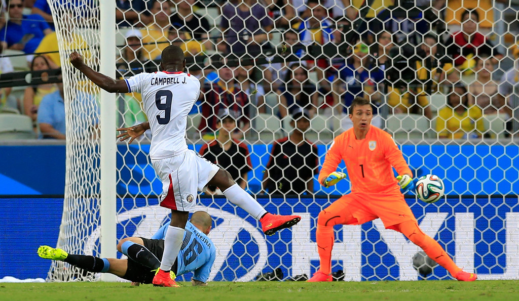 . Costa Rica\'s Joel Campbell scores his side\'s first goal during the group D World Cup soccer match between Uruguay and Costa Rica at the Arena Castelao in Fortaleza, Brazil, Saturday, June 14, 2014. (AP Photo/Bernat Armangue)