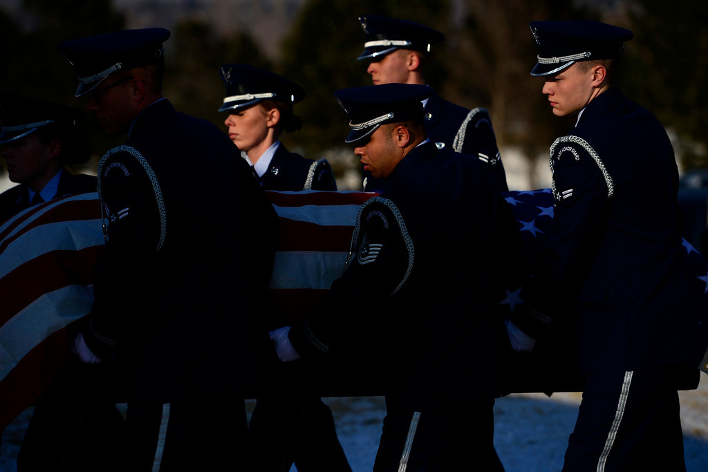 . The honor guard carries the casket during the funeral service for Colonel Fitzroy Newsum at Fort Logan National Cemetery on Monday, January 14, 2013. Newsum, who was 94, served as a Tuskegee Airman during his military service. AAron Ontiveroz, The Denver Post
