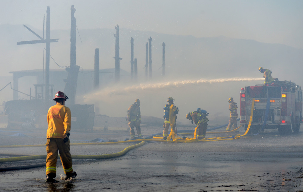 . Firefighters battle a five alarm fire Saturday, May 4, 2013, at a pallet yard in the 8300 block of Sultana Avenue in Fontana. Jennifer Cappuccio Maher/Daily Bulletin
