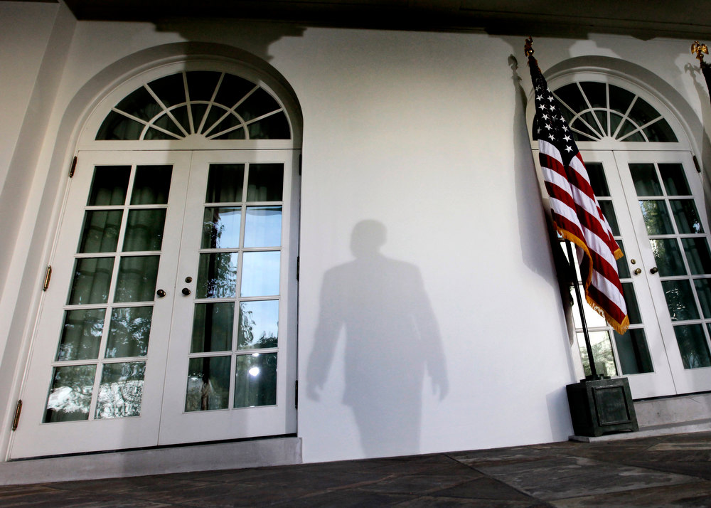 Description of . In this Tuesday, Oct. 13, 2009 file photo, the shadow of President Barack Obama is cast on a wall as he leaves a news conference in the Rose Garden of the White House in Washington after the Senate Finance Committee voted to approve a health care bill. (AP Photo/Pablo Martinez Monsivais)